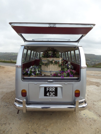 Wicker coffin inside alternative hearse